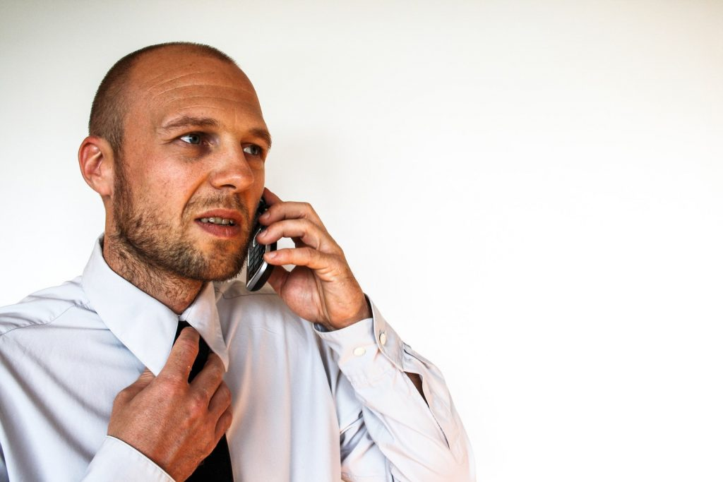 stop creditor harassment - phone on phone looking upset