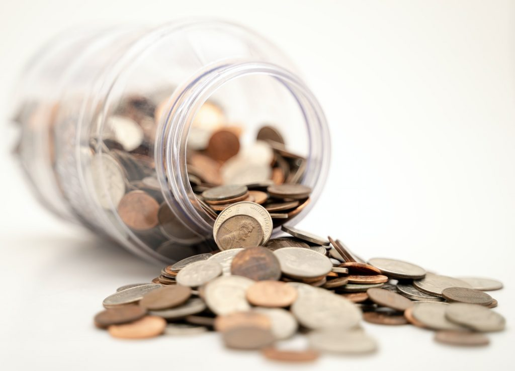 bankruptcy process - jar with coins spilling out